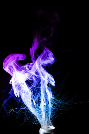 Color vape clouds of fog. Two colour blue and purple clouds of fog with visible tracers. Vape culture and no smoking.