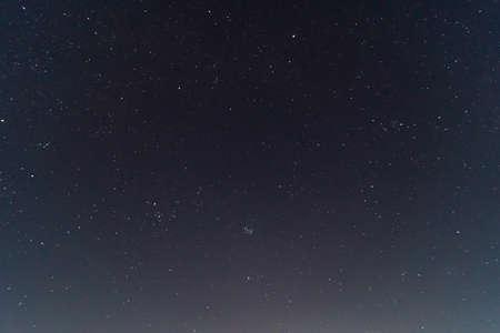 Underexposed night sky low light photo. A lot of stars and constellations on dark sky. Stock photo of deep sky.