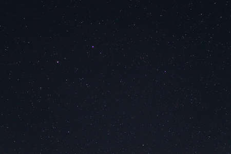 Night sky low light photo. A lot of stars and constellations on dark sky. Stock photo of deep sky. Far away from city and no clouds.