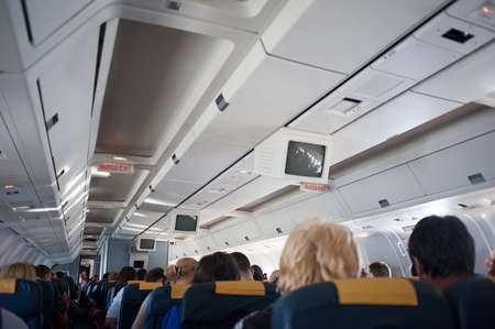 flew: The interior of the aircraft with passengers, flew