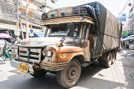 scrap trade: Old used pickup truck on a city street Thailand Stock Photo