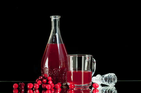 cranberry juice: Red liquor, cranberry juice, cranberry juice Isolated on a black background. Stock Photo