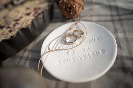 weddingrings: Wedding rings in white gold, white clay saucer with the word always have to be your friend