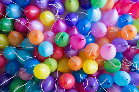 attachment: festive, colorful balloons with helium. attachment to the white ribbons Stock Photo