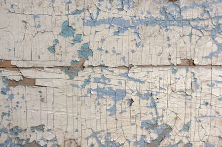 Texture, pattern, background old paint. the wooden wall cracked with paint. With a white tinge, the paint eventually peels off Stock Photo