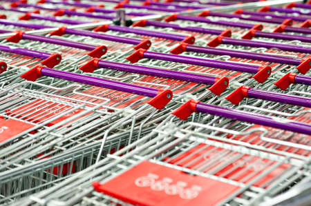 Row of supermarket shopping cart trolleys vintage look. Stock Photo