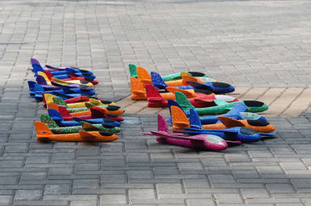 Aircraft made of foam on the asphalt in the park. Childrens toy