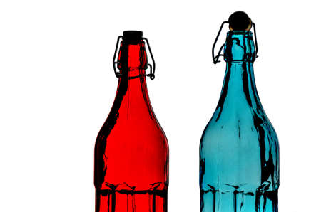 close-up of beautiful colorful empty bottles with drag caps isolated on a white studio background
