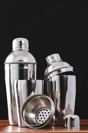 Three cocktail shakers for making summer cocktails at the bar. European shaker in disassembled form: glass, sieve, lid