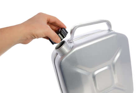 A mans hand opens a metal can for gasoline, isolated on a white background.