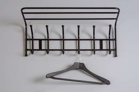 black clothes hanger on a gray wall background