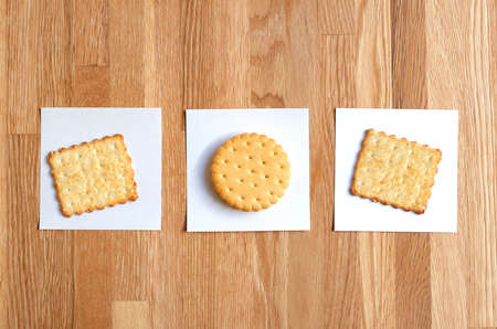 two crackers and cookies with filling, laid out on white stickers