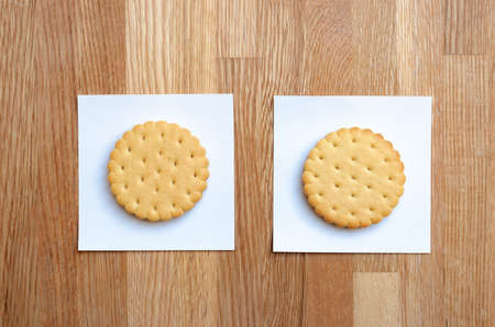 two cookies with filling, laid out on white stickers