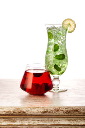 two cocktails on the wooden table isolated on white background, clipping path