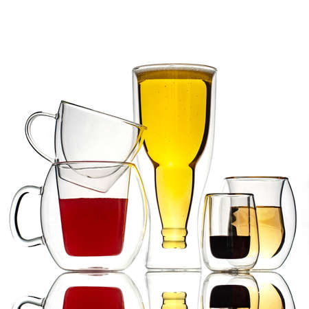 Glasses and cups with double walls, on a white background. Isolated