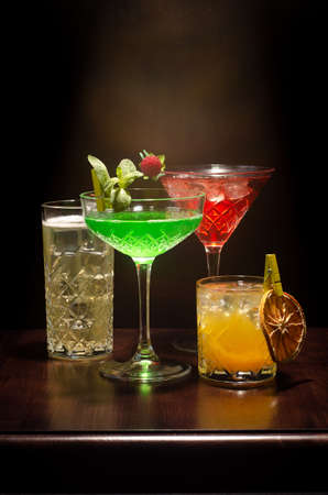 Various cocktails on a light and dark background