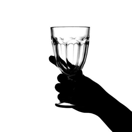 Hand holds a glass on a white background. isolate. Siluet
