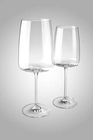 Two empty wine glasses isolated on white