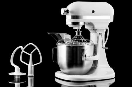 White kitchen mixer isolated on a black background