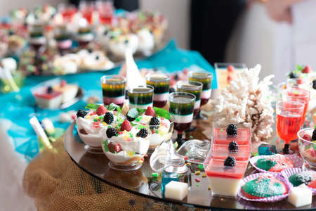 Luxurious desserts and drinks at the buffet table. Shallow depth of field.