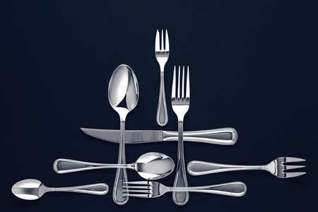Stylish cutlery, on a dark blue background. View from above. Free space for text
