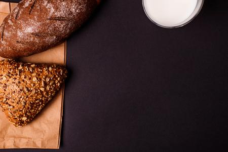 Tasty bake with milk on dark background. Copy space