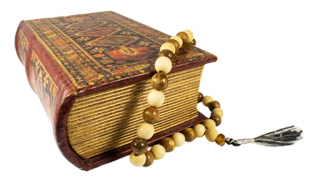 Ancient book and rosary