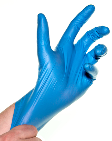 Doctor wearing blue rubber gloves 스톡 콘텐츠