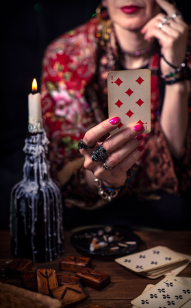 Gypsy fortune teller predicts the future with cards Stock Photo