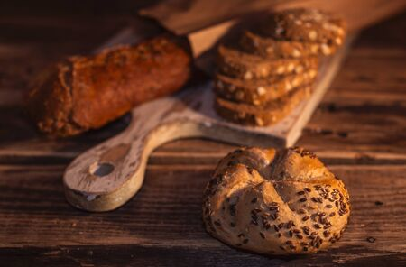 Various homemade bread on rural wooden background
