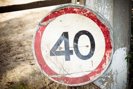 Road sign on a pillar, warning