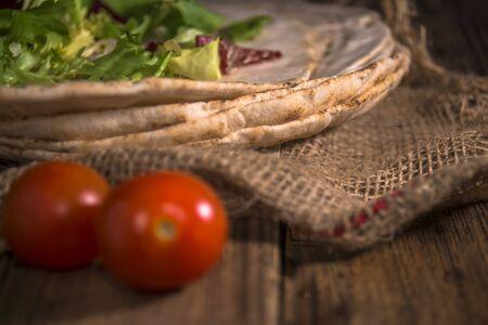 Pitta bread on rural wooden background