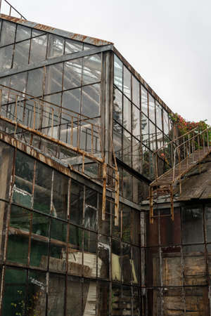 Exterior of rusty old abandoned greenhouse
