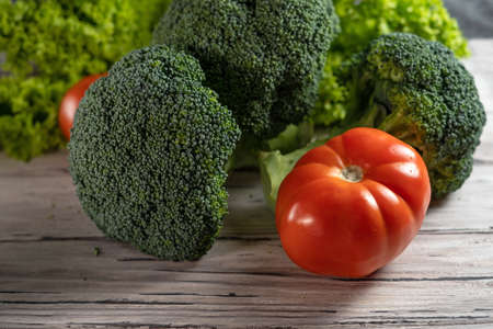 Vegetable still life with broccoli, tomatoes and salad