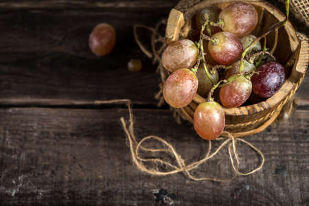Rural still life with grapes on wooden table