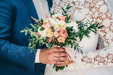 Groom hugs bride. bridal bouquet Reklamní fotografie