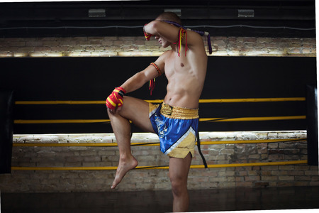 bowing head: Man Fighter Muay Thai Stand in the ring