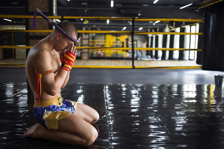 bowing head: Man Fighter Muay Thai bowed in the ring Stock Photo