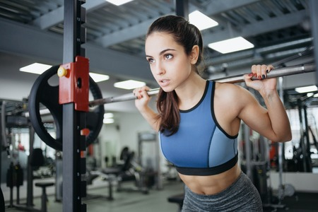 Young woman at the gym using fitness equipment. Stock Photo