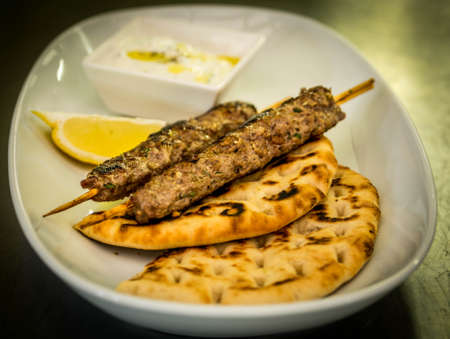 tzatziki: Beef kebab with bread and tzatziki sauce