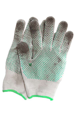 gardening gloves: A pair of dirty gardening gloves. The inner side of rubberized