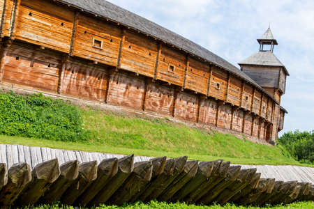 palisade: old wooden fort with palisade. Stock Photo