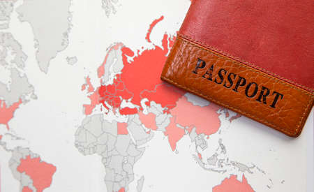 tour operator: passport cover in orange on a background map of the world