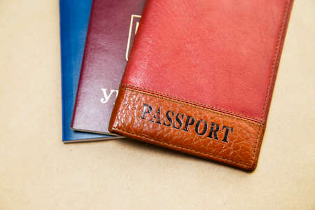 ides: three passports of different colors on the table