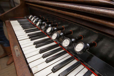 orchestration: old keyboard musical instrument with keys close-up