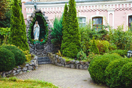 mother god: Statue of the Virgin Mary in the park in Berdychev Stock Photo