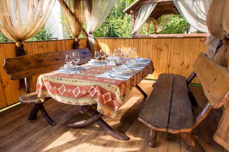 gazebo: gazebo in nature. inside the gazebo served table Stock Photo