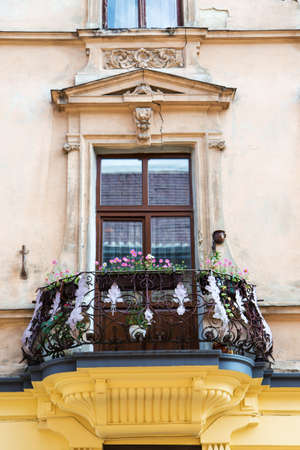 balcony: old balcony with flowers. balcony over the cracks and modeling Stock Photo