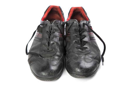disrupt: worn black mens shoes isolated