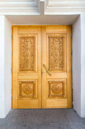 wicket gate: yellow wooden doors with carvings